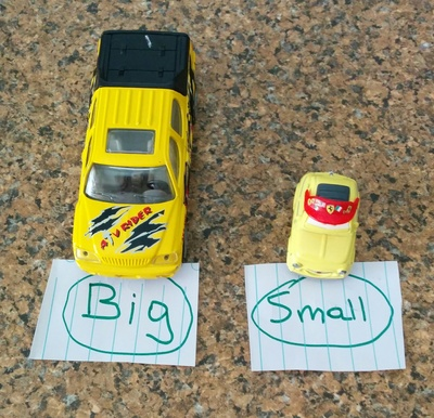 Big, small, car, cars, toy cars, writing, label, bench, toys
