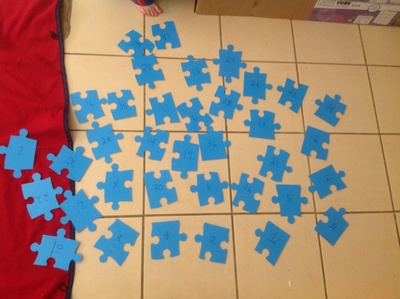 Puzzle, puzzle pieces, numbers, marker, upside down, rug, pictures